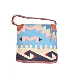 large vintage kilim wool and leather bag. $145.00, via Etsy.