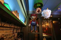 You can now have a drink with Mario and Luigi in the Mushroom Kingdom.   D.C.'s Mockingbird Hill cocktail bar has become a paradise for any Mario-loving video game geek. The space is fully decked out in Mario decorations, including animatronic piranha plants moving in and out of green warp pipes on the ceiling, illuminated mystery boxes, floating mushrooms, and incredibly intricate scene made of Legos above the bar.   Even the cocktails pay homage to the theme, too, including drinks like the…