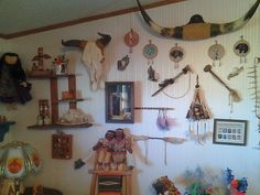 One wall in my living room covered with Native American Indian artifacts.