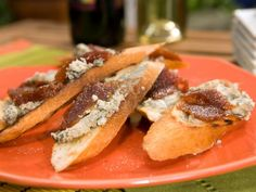 Get Crostini with Blue Cheese, Quince Paste and Cracked Black Pepper Recipe from Food Network (cheese board) Bobby Flay