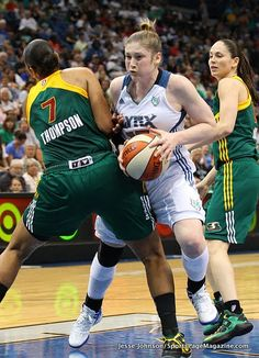 Tina Thompson, Lindsay Whalen fight over ball--Sue Bird in background