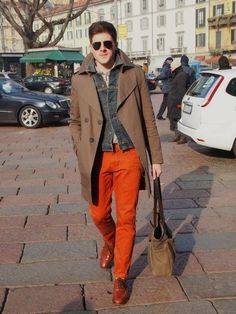Go for a brown trenchcoat and orange chinos to create a smart casual look. Show your sartorial prowess with a pair of brown leather oxford shoes.  Shop this look for $531:  http://lookastic.com/men/looks/chinos-and-longsleeve-shirt-and-denim-jacket-and-trenchcoat-and-tote-bag-and-oxford-shoes/3874  — Orange Chinos  — Grey Longsleeve Shirt  — Charcoal Denim Jacket  — Brown Trenchcoat  — Brown Canvas Tote  — Brown Leather Oxford Shoes