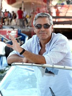 Age 50  Swoon! The actor looks cool and confident as he relaxes on a boat in Venice,Italy, on Aug. 16. Is there room for one more on that yacht?    FILED UNDER: