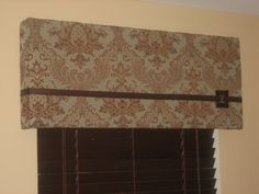 Cornices instead of curtains because we have sweet wood blinds in every window of the house.
