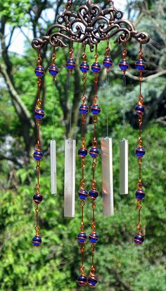 Windchime / Wind Chime with Recycled Aluminum and Copper Wrapped Cobalt Blue Glass Marble Prisms. $19.00, via Etsy.