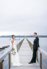 Sweetgrass Social Wedding at Lowndes Grove in Charleston, SC. Lauren & Kyle. Bride and groom pictures on dock with white bridal bouquet.