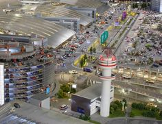 Miniatur Wunderland in Hamburg, Germany, is home to the world's largest model railway, with miniature replicas of famous destinations around Europe and America. The level of detail is incredible and the figures are simply mind-boggling: - Model area = sq. Airport Design, City Model, Hamburg Germany, Model Building, Model Trains, Scale Models, Worlds Largest, Wonderland, Doll Houses