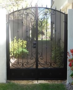 Wrought iron double gate with scrolls, knuckles and arrow finials Wrought Iron Driveway Gates, Iron Gates, Double Gate, Double Doors, Courtyard Entry, Boulder City, North Las Vegas, Door Gate, Block Wall