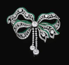 A Belle Epoque emerald and diamond brooch, circa Designed as a tied ribbon, millegrain set with circular-cut diamonds, accented with lines of carré-cut emeralds, detachable brooch pin to reverse. Bow Jewelry, Emerald Jewelry, Art Deco Jewelry, High Jewelry, Jewelery, Jewelry Design, Jewelry Stores, Jewellery Shops, Jewellery Box