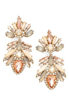 A dramatic mix of slender marquise crystals and opaque jewels capture the elegance with these dramatic drop earrings that add a dose of pastel-colored shine to any look.
