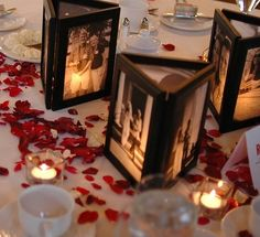 This cute add-on to your centerpieces is totally DIY! To create these photo frames, remove the back of picture frames and glue them together. Place a flameless candle in the middle to illuminate the photos.