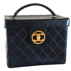 1980s Chanel Black Quilted Lambskin Vanity Cosmetic Train Case   From a collection of rare vintage top handle bags at https://www.1stdibs.com/fashion/handbags-purses-bags/top-handle-bags/