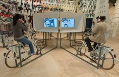 People use generator-equipped bikes to play info videos at the booth of Brazil at the Frankfurt Book Fair 2013 on October 8, 2013 in Frankfurt am Main, western Germany. Brazil is the guest of honor of the 2013 book fair held from October 9 to 13, 2013.