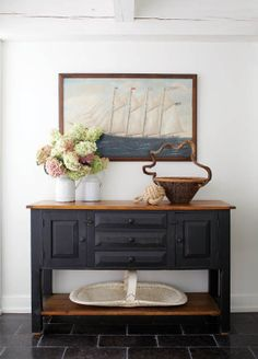A schooner painting by William P. Stubbs gets prominent placement in the entry hall.