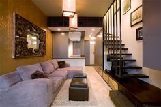 narrow living room with exposed stairs