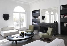 Joseph Dirand's characteristic minimalist contemporary style seen in his latest project in Neuilly, France... infused with modern and vintage pieces.