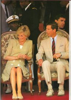 March 22, 1990:  Prince Charles and Princess Diana at a display of traditional dancing at the Bamenda Electrification Plant in Bamenda, Cameroon