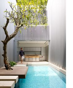 I love everything about this, the colour of the pool against the walls, the giant concrete stepping stones, the tree that represents nature as art....