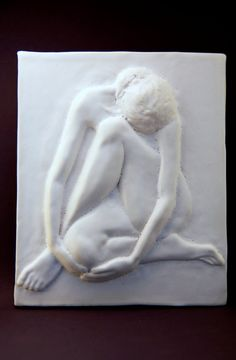 Corinda Genev Ceramics. Sold at: https://www.etsy.com/listing/151973609/eloquent-nude-ceramic-bas-relief-made?ref=shop_home_feat