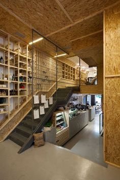 OSB trimmed out with pine Commercial Interior Design, Commercial Interiors, Cafe Restaurant, Restaurant Design, Cafe Design, Store Design, Chipboard Interior, Casa Bonay, Osb Wood