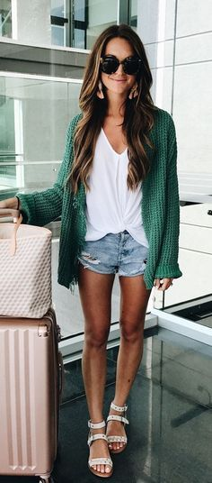 This twist-front top and chunky green sweater are perfect for travel