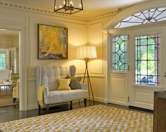 Entryway with touches of yellow...love the petite sofa