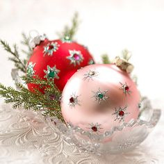 BHG: Use puff paint to make a star or circle, while still wet, put a rhinestone in the middle. Supplies: plain colored ornaments puff paint rhinestones