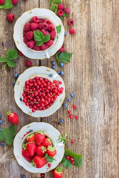 Raspberry , red currant and strawberry with green leaves in cups, top view by Anastasy Yarmolovich #AnastasyYarmolovichFineArtPhotography  #ArtForHome #Food