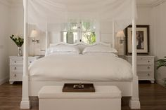 Four-poster in white at Sugar Beach, St Lucia, in the Caribbean.