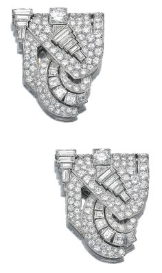 Diamond double clip brooch, 1930s. Of geometric design, set with circular-, carré-, single-cut, triangular and baguette diamonds, brooch pin detachable, fitted case.