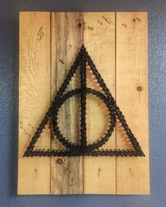 Harry Potter String Art.   Deathly Hallows. 9.29.16 #harrypotter #deathlyhallows #stringart #pallet #rustic #homedecor #buffalosage