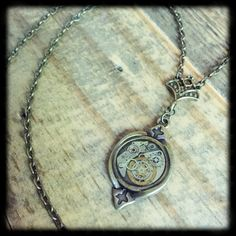 Beauty and machinery meet in the epitome of the Steampunk era. Vintage watch gears, each hand-placed, cover a .75-inch bronze-tone pendant. Your pendant is coated in clear resin to be easy and safe to wear, so add some steampunk flair to every outfit with no fear of damaging your jewelry. Hangs on a 24 bronze-tone chain. Chain length can be adjusted upon request.  Each Machine88 piece is hand assembled and one of a kind.  Please feel free to message with questions or requests