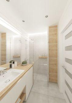 Los tonos claros en combinación con la madera son los protagonistas de los baños en este 2016