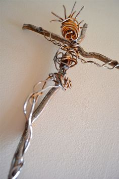 The twisted form of Jesus is made of old scrap wire and the cross itself is welded from railroad scrap iron. This is one of my favorite crosses. The shadows on the wall are dramatic! To purchase, go to: http://www.etsy.com/listing/94335863/heir-to-righteousness-industrial-and