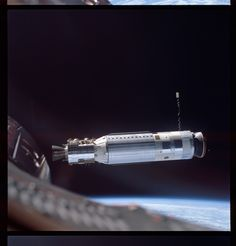 The Gemini VIII mission docked with the unmanned Agena craft, seen floating above the world in this image. This technique was utilized later on during the Apollo missions to attach the crew module with the lunar lander.
