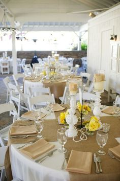 Burlap and yellow - like the tall candlestick; could use w/blue mason jars instead of crystal