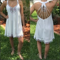 🎉1 HOUR SALE🎉White Tassel Dress Hip dress with an embroidered neckline💕Gorgeous strapped back & tassels along hemline. ♦️Price is firm unless bundled♦️ Dresses Midi