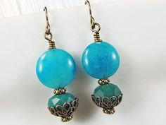 Turquoise & Antiqued Brass drop earrings by Hancelscloset on Etsy