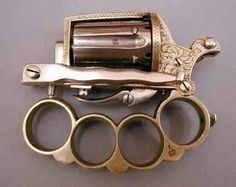 This is a dagger, knuckleduster and pistol all in one. Sort of a deadly swiss army knife.