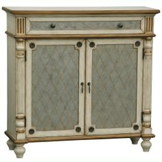 hall chest with a top drawer and trellis overlay. Features fluted corner accents and turned bun feet. Product: Hall chestConstruction Material: Wood and hardwood solidsColor: Tan and aged silverFeatures: Two doors and one drawerDimensions: H x W x D Decor, Accent Chests And Cabinets, Living Furniture, Painted Furniture, Hand Painted Furniture, Furniture, Accent Decor, Mattress Furniture, Accent Chest