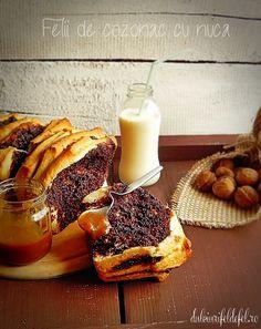 Mod de preparare Felii de cozonac cu nuca: Umplutura: Intr-un castron amestecam nuca macinata cu zaharul si cacaoa, esenta de rom si scortisoara, apoi se toarna lapte fierbinte deasupra. Se pune lapte pana se obtine consistenta dorita. Aluat: Intr-o craticioara punem laptele, untul, zaharul, sarea si coaja de lamaie. Incalzim…