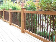Cedar Deck Railing with Iron View more Deck Railing Ideas http://awoodrailing.com/2014/11/16/100s-of-deck-railing-ideas-designs/