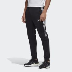 Throw these adidas pants into your everyday rotation. Clean and simple, they have all the makings of a wardrobe staple. Wear them with a sweatshirt or tee for head-to-toe athletic style, or slip them on to complement a more elevated look. All White Shoes, Blue Shoes, Blue Adidas, Adidas Men, Adidas Hose, Sports Football, Athletic Fashion, Athletic Style, Fleece Joggers