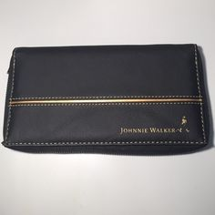 Johnnie Walker Wallet Black Zip Around Johnnie Walker Wallet Black Zip Around with Gold Trim lots of slots for credit cards & ID & inside compartment has JW print Very Cool Wallet (Slight Use Like New) Johnnie Walker Bags Wallets