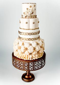 Four-tiered ivory cake inspired by a wedding gown with a billowing bottom tier, gold banding and button details by Whimsical Wedding Cakes, Milton, ON, Canada. Photo by Heather Smith of Madley In Love Photography. Via Grace Ormond Wedding Style.