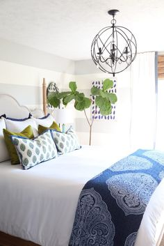 Blue and green paisley guest bedroom with fall accents