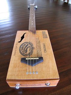 Cigar Box Guitar by BarefootBoogieGuitar nice string attachment. Ukulele Stand, Cigar Box Guitar Plans, Broom Handle, Homemade Instruments, Scrap Material, Christmas Gift Baskets, Guitar Building, Guitar Tips, Cigar Boxes