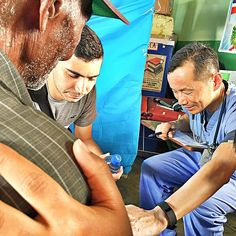 Dr Dave praying with one of his patients at the Batey - #haitian #medmissionDR #medical