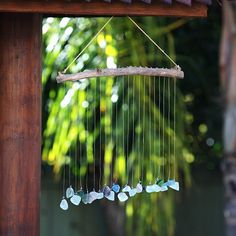 Unique mobile hangs gracefully with natural colors and texture to soothe and relax the mind. 4 foot long Sea Glass and Driftwood Mobile imitates a gentle rain shower for a unique garden accent, perfec