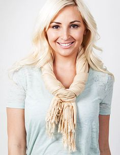 How To Tie a Scarf @ Scarves.com  Also - check out Le Beau Cou's free Scarf Tying Guide to Get you Through the Week! at http://www.lebeaucou.com